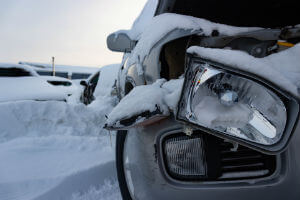 grey-car-snow-damaged-headlight