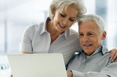 Elderly Couple Looking At A Laptop